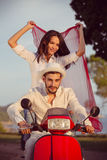 Couple in love riding a motorbike , Handsome guy and young sexy woman travel . Royalty Free Stock Photography