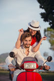 Couple in love riding a motorbike , Handsome guy and young sexy woman travel . Stock Images