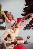 Couple in love riding a motorbike , Handsome guy and young sexy woman travel . Royalty Free Stock Image
