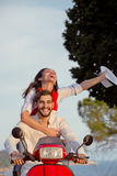 Couple in love riding a motorbike , Handsome guy and young sexy woman travel . Stock Image