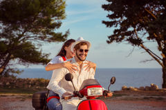 Couple in love riding a motorbike , Handsome guy and young woman travel . Stock Photo