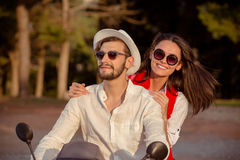 Couple in love riding a motorbike , Handsome guy and young woman travel . Stock Photography