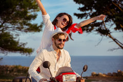Couple in love riding a motorbike , Handsome guy and young woman travel . Royalty Free Stock Photo