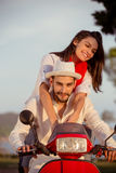 Couple in love riding a motorbike , Handsome guy and young woman travel . Royalty Free Stock Photos
