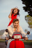 Couple in love riding a motorbike , Handsome guy and young sexy woman travel . Royalty Free Stock Photos