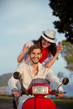 Couple in love riding a motorbike , Handsome guy and young sexy woman travel . Royalty Free Stock Photo