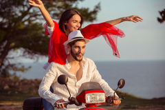 Couple in love riding a motorbike , Handsome guy and young sexy woman travel . Stock Photos