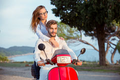 Couple in love riding a motorbike , Handsome guy and young sexy woman travel . Stock Photo