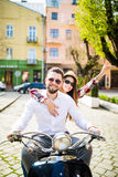 Couple in love riding a motorbike. Young riders enjoying themselves on trip. Couple in love riding a motorbike , Handsome guy and young sexy women travel Stock Image