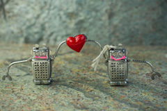 Couple in love of  robots with a heart. St. Valentines Day concept. Royalty Free Stock Photos