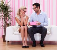Couple in love romancing on the couch Royalty Free Stock Photos
