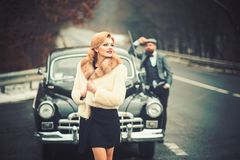 Couple in love on romantic date. Retro collection car and auto repair by mechanic driver. Travel and business trip or royalty free stock photos