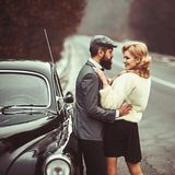 Couple in love on romantic date. Travel and business trip or hitch hiking. Bearded man and sexy woman in fur coat. Retro. Couple in love on romantic date. Travel royalty free stock images
