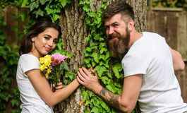 Couple in love romantic date walk nature tree background. Pleasant date in nature environment. Man bearded hipster holds. Hand girlfriend. Couple in love lean stock images