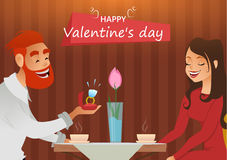Couple in love, romantic evening in restaurant or cafe, young man presents ring with big diamond to his beloved. Greeting card. Da Stock Image