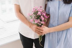 Couple in love. Romantic man giving flowers to his girlfriend.  Royalty Free Stock Photo