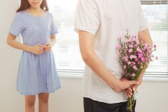 Couple in love. Romantic man giving flowers to his girlfriend. Couple in love. Romantic men giving flowers to his girlfriend Royalty Free Stock Photos
