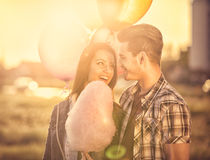 Couple in love, romantic setting at amusement park Royalty Free Stock Photography