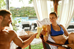 Couple In Love On Romantic Vacation With Cocktails At Spa Stock Photos