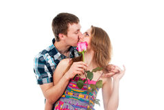 Couple in love with a rose. Kissing couple in love with a rose Stock Photography