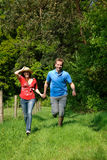 Couple love running nature. Young handsome running couple, man and woman in love, nature setting stock photography