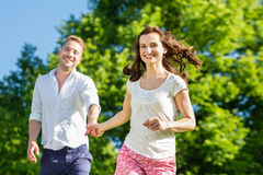 Couple in love running Royalty Free Stock Photos