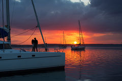 Couple in love on sailboat at sunset Stock Photography