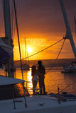 Couple in love on sailboat at sunset Stock Images