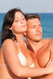 Couple in love on sea Stock Images