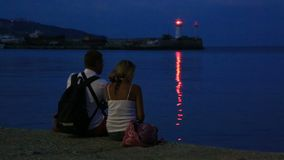 Couple in love on the seafront in the evening stock footage