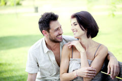 Couple in love seated together on a bench. In vacation stock image