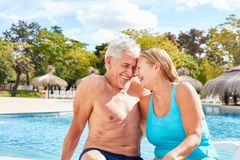 Couple in love seniors enjoying the spa holiday by the pool. From the hotel royalty free stock image