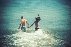 Couple in love with body relax on beach. Summer holidays and paradise travel vacation. woman and man run in. Couple in love with body relax on beach. Summer royalty free stock image
