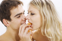 Couple in love sharing fruit Stock Image