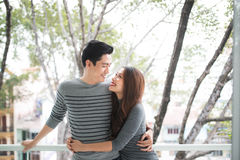 Couple in love sharing genuine emotions and happiness, hugging o Stock Photography
