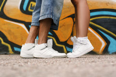 Couple in love. Shoes close up. White shoes on the asphalt. Stock Photos