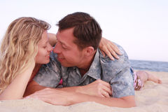 Couple in love on the shore of the sea Stock Images