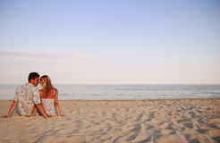 Couple in love on the shore of the sea Royalty Free Stock Image