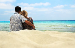 Couple in love on the shore of the sea Royalty Free Stock Photo