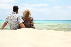 Couple in love on the shore of the sea Royalty Free Stock Photography