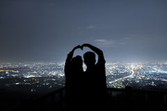 Couple in love silhouette on the mountain ,love and valentines c. Oncept, long exposure astronomical photograph Stock Image