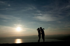 Couple in love silhouette. During sunset Stock Image