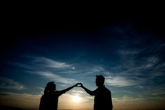 Couple in love silhouette. During sunset Stock Photos