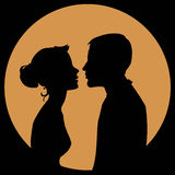 Couple in love. Silhouette of a couple in love on a yellow background Stock Photography