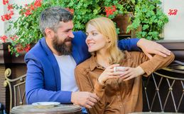 Couple in love sit cafe terrace enjoy coffee. Girl dating with businessman. Dating businessman. Couple cuddling cafe. Terrace. Things know before you date royalty free stock photo