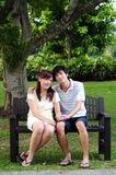 Couple in Love sitting on bench Stock Photography