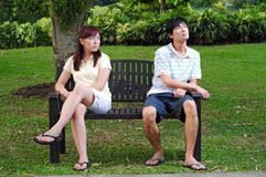 Couple in Love sitting on bench angry 3 Royalty Free Stock Photography