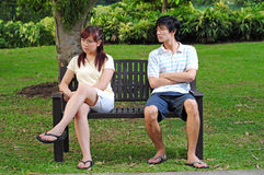 Couple in Love sitting on bench with various poses Royalty Free Stock Photography