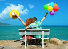 Couple in love sitting  coast while honeymoon. Royalty Free Stock Photo