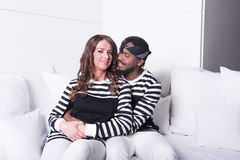 Couple in love sitting on couch Stock Photography